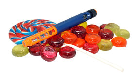 Diabetic Insulin Pen And Candy Stock Image