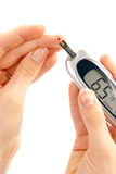 Diabetic patient measuring glucose level blood Royalty Free Stock Photography