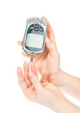 Diabetic patient measuring glucose level blood test Royalty Free Stock Images