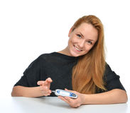 Diabetic patient measuring glucose level blood test using ultra stock photos