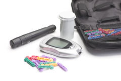 Diabetic Testing Supplies. With glucometer and multi-colored lancets stock images