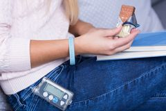 Diabetic woman eating sweets. Close-up of ill diabetic woman eating sweets stock photography
