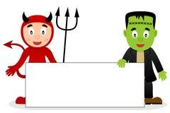 Diable rouge et Frankenstein avec la bannière vide Photos stock