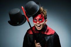 Diablo divertido contra Fotos de archivo libres de regalías