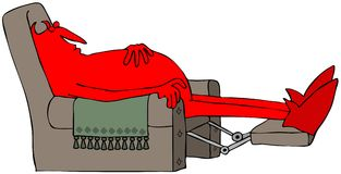 Diablo rojo que duerme en un recliner marrón Imagenes de archivo