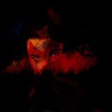 Diablo y fuego Imagen de archivo