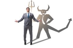 Diabo que esconde no homem de negócios - conceito do alter ego fotografia de stock royalty free