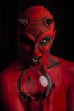 Diabo vermelho com esfera de cristal. foto de stock royalty free