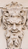 Diabolical mask on the exterior facade of a house in Augsburg (Germany) Royalty Free Stock Image