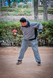 Diabolo. Beijing, China - March 28th, 2013: Chinese man playing diabolo in Jingshan Park Royalty Free Stock Images