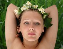 Diadem. Young beautiful blond in jasmine diadem, on grass background, contains clipping path Stock Images