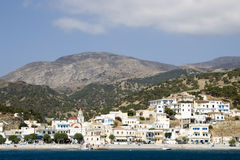 Diafani - small Greek seaside village in Karpathos. View from the sea. Diafani village is situated in a bay on  north-east coast of Karpathos. Dodecanese Islands Stock Photos