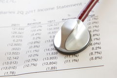 Diagnose a companys income statement. And financial situation stock images