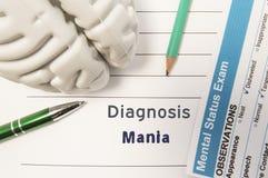 Diagnosen-Manie Zahl des menschlichen Gehirns, Ergebnis der Geistesstatusprüfung, Stift und Bleistift umgaben geschriebene psychi Lizenzfreie Stockfotos