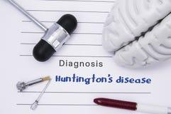 Diagnosi neurologica della malattia del ` s di Huntington Il martello neurologico, la figura del cervello umano, strumenti per pr immagine stock