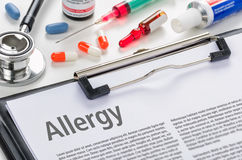 Diagnosis allergy written on a clipboard Royalty Free Stock Photography