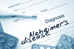 Diagnosis Alzheimers disease and tablets. Royalty Free Stock Photo
