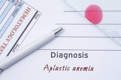 Diagnosis Aplastic anemia. Written by doctor hematological diagnosis Aplastic anemia in medical report, which are result of blood royalty free stock photos