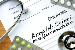 Diagnosis Arnold-Chiari malformation and stethoscope. Diagnosis Arnold-Chiari malformation, pills and stethoscope royalty free stock images
