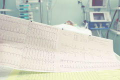 Diagnosis of cardiac arrhythmias in the ICU. The doctor examines Stock Photography
