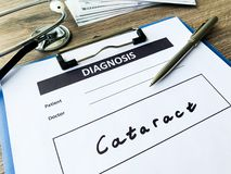 Diagnosis cataract in a medical form on the doctor desk.  royalty free stock image