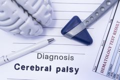 Diagnosis Cerebral palsy. Figure brain, neurological hammer, printed on a paper blood test and written diagnosis of Cerebral palsy. In  medical form is lying on stock images