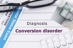 Diagnosis Conversion disorder. Medical notebook labeled Diagnosis Conversion disorder, psychiatric mental questionnaire and pills stock photos