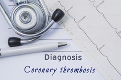 Diagnosis of Coronary thrombosis. Stethoscope, electrocardiogram are on paper medical form where indicated cardiological diagnosis. Coronary thrombosis. Concept Royalty Free Stock Images