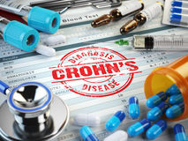 Diagnosis de la enfermedad de Crohns Sello, estetoscopio, jeringuilla Foto de archivo libre de regalías