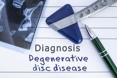 Diagnosis degenerative disc disease. Medical health history written with diagnosis of Lumbar disc disease, MRI image sacral spine royalty free stock photo