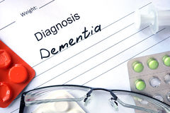 Diagnosis Dementia, pills. Diagnosis Dementia, pills and stethoscope stock images