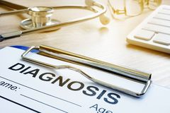Diagnosis form on a hospital desk. Medicine or health care. stock images