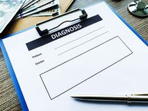 Diagnosis form with the patient`s data on the doctors desk. Diagnosis form with the patient`s data on the doctors desk royalty free stock images