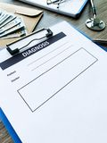 Diagnosis form with the patient`s data on the doctors desk. Diagnosis form with the patient`s data on the doctors desk stock image