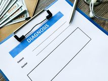 Diagnosis form with the patient`s data on the doctors desk. Diagnosis form with the patient`s data on the doctors desk royalty free stock photo