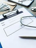 Diagnosis form with the patient`s data on the doctors desk. Diagnosis form with the patient`s data on the doctors desk royalty free stock photos