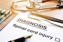 Diagnosis form with Spinal cord injury. Diagnosis form with Spinal cord injury on a desk stock images