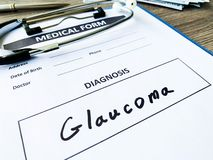Diagnosis glaucoma in a medical form on the doctor desk. Diagnosis glaucoma in a medical form on the doctor desk stock photo