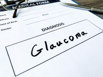 Diagnosis glaucoma in a medical form on the doctor desk. Diagnosis glaucoma in a medical form on the doctor desk stock photos