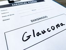 Diagnosis glaucome in a medical form on the doctor desk. Diagnosis glaucome in a medical form on the doctor desk stock photos