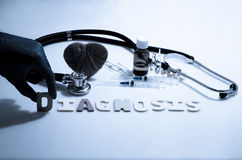 Diagnosis. Hand and diagnosis word on the white background royalty free stock photo