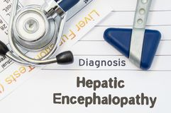 Diagnosis Hepatic Encephalopathy. Neurological hammer, stethoscope and liver laboratory test lie on note with title of Hepatic Enc. Ephalopathy. Concept for stock photography