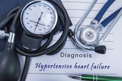 Diagnosis Hypertensive heart failure. A stethoscope, sphygmomanometer with a cuff lie on medical form documentation with diagnosis. Hypertensive heart failure stock image