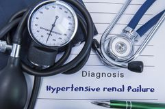 Diagnosis Hypertensive renal failure. A stethoscope, sphygmomanometer with a cuff lie on medical form documentation with diagnosis stock images