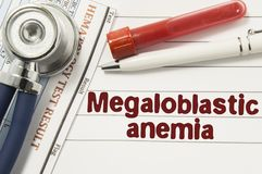 Diagnosis of Megaloblastic Anemia. Test tubes or bottles for blood, stethoscope and laboratory hematology analysis surrounded by t. Ext title of diagnosis of stock photos