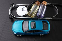 Diagnosis of a passenger car. Repair and troubleshooting in car workshops. Dark background stock image