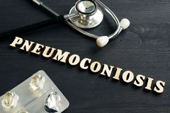 Diagnosis Pneumoconiosis, stethoscope and pills. On the desk royalty free stock photography