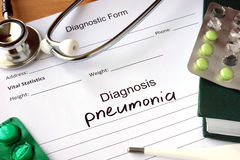 Diagnosis pneumonia  and stethoscope. Stock Photos