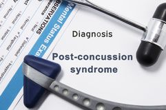 Diagnosis of Post-Concussion Syndrome. Two neurological hammer, result of mental status exam and name of neurologic psychiatric di. Agnosis Post-Concussion royalty free stock photo