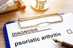 Diagnosis psoriatic arthritis and clipboard. stock photo
